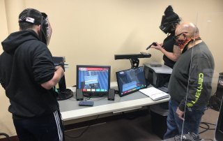 Students using Lincoln Electric VRTEX® virtual reality arc welding trainers.