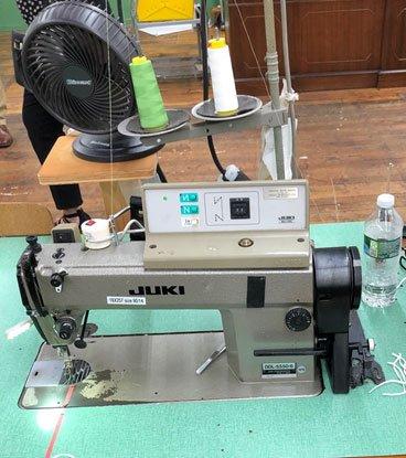 Photo of a stitching machine.